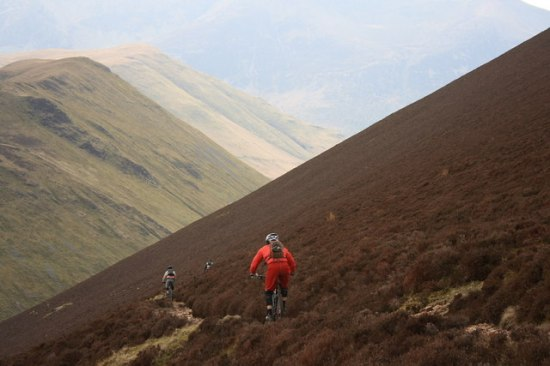 Mountain bikers descending a ridge in the steep hills of the English Lake District. Source: Mick Garratt via Wikimedia Commons.